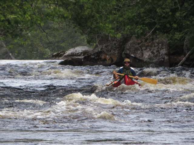 fellow paddlers riding the rapids