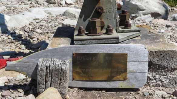 memorial on paddle at fire tower base
