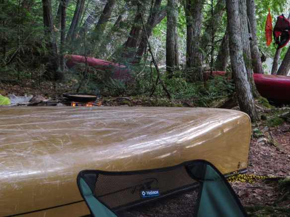overturned canoes at the campsite