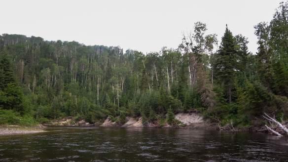 steep sandy banks The Steel River below Rainbow Falls
