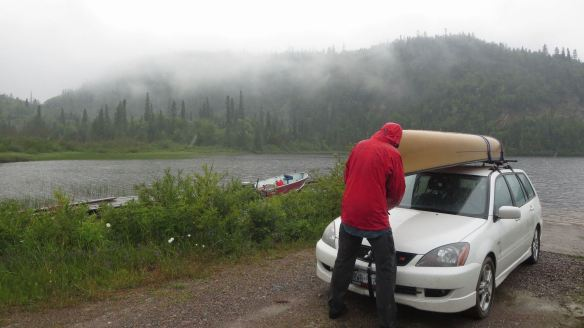 strapping down the canoe