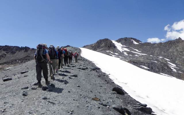 trekkers' line to the day's peak