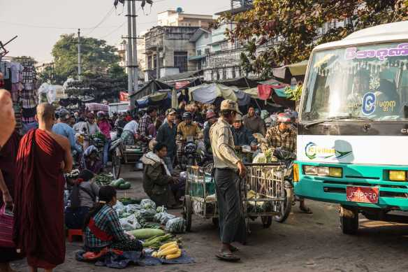 a traffic jam on a Zay Cho street not meant for buses!