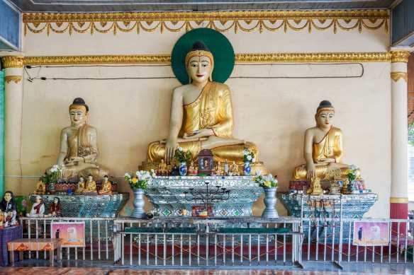 another shrine area with seated Buddhas and nat figures