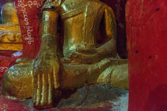 crudely sculpted Buddha figure in touching the earth mudra