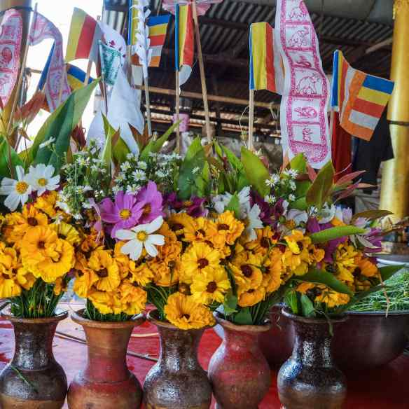 flowers and other items for sale outside of Hithsa Gon Paya