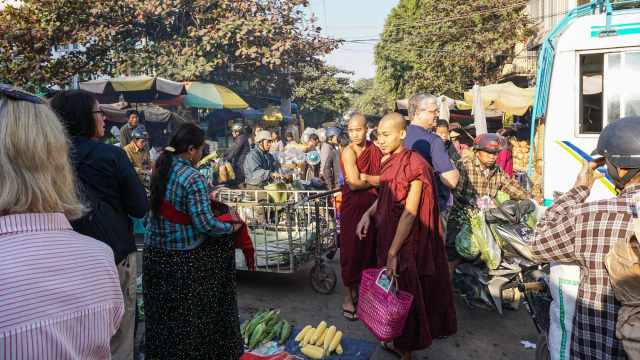 monks and tourists in the midst of a traffic jam