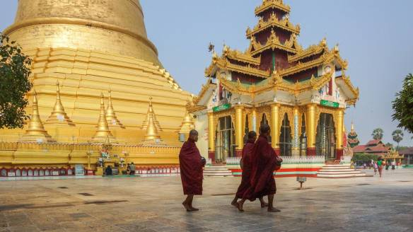 monks walking past one of the pavilions on the Shwemawdaw terrace