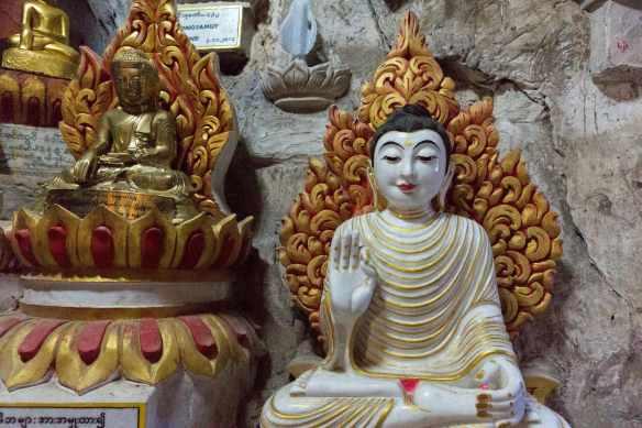 seated buddha with unusual hand gesture