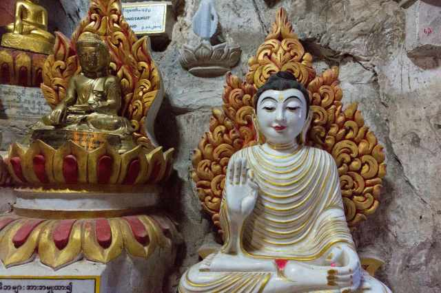 seated buddha with unusual hand gesture