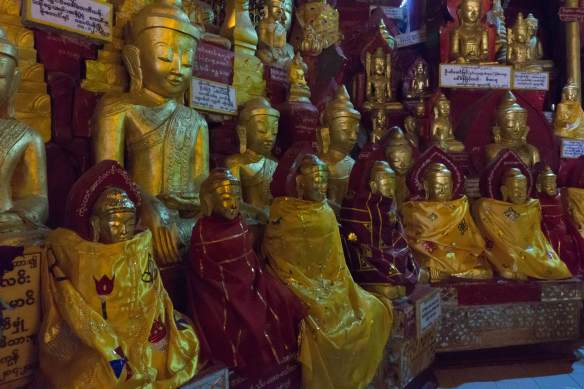 seated Buddhas wrapped in silk