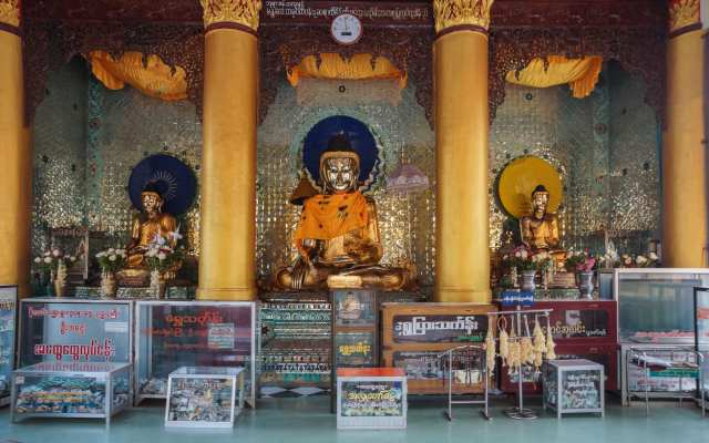 shrine with donation boxes near entrance of Shwemawdaw Pagoda in Bago