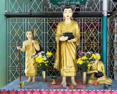 statues of monks in side shrine area