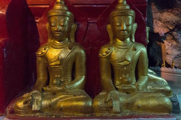 two Buddhas in same mudra- bent index finger on right hand