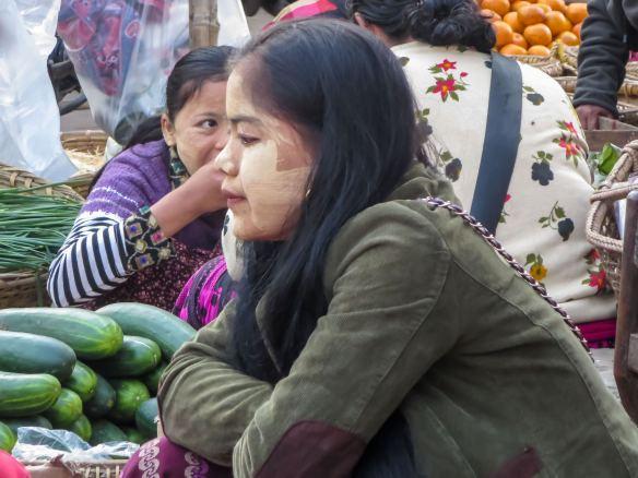 a Zay Cho vendor contemplates the scene