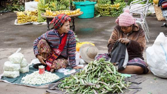 Zay Cho produce sellers sit on their mats