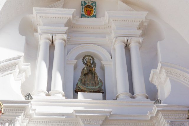 a statue of Our Lady of Copacabana above the basilica entrance