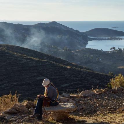 a traveller contemplating at Isla del Sol's mirador
