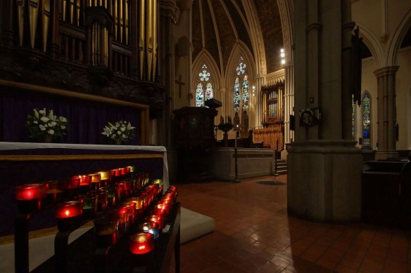 candles - and a Station of the Cross on the pillar - at St. James Catehdral on King Street