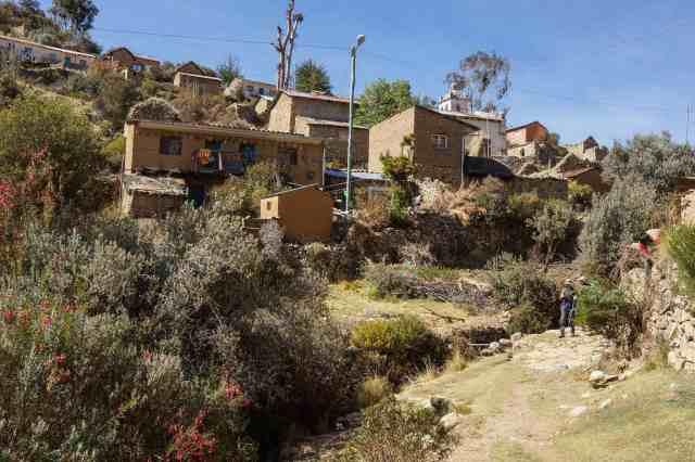leaving the village of Sampaya on a rough trail