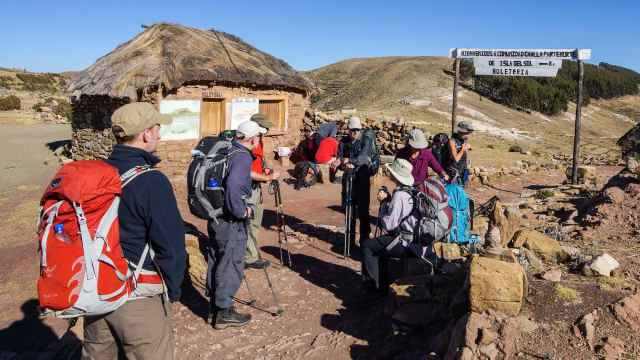 trekking roup waits while guide pays the toll