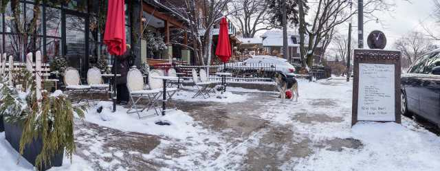 The Rooster patio and snow-covered chairs