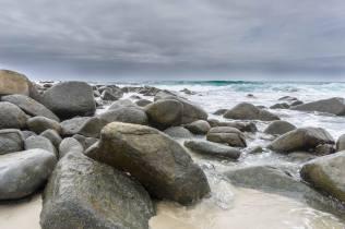 beach boulders on a cloudy afternoon on east coast Tas