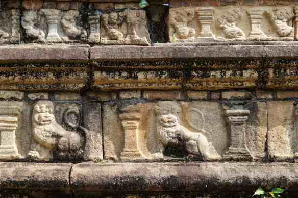 the lion and dwarf friezes above the elephants on the base of Polonnaruwa's Council Chamber
