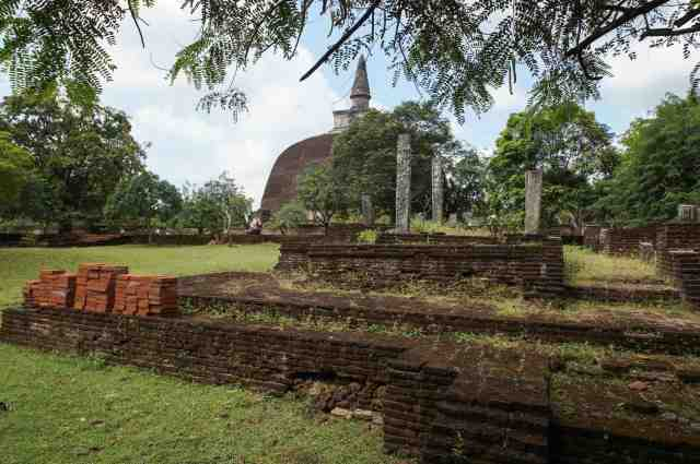 a first view of the Rankot Vihara - the largest of Polonnaruwa's dagobas
