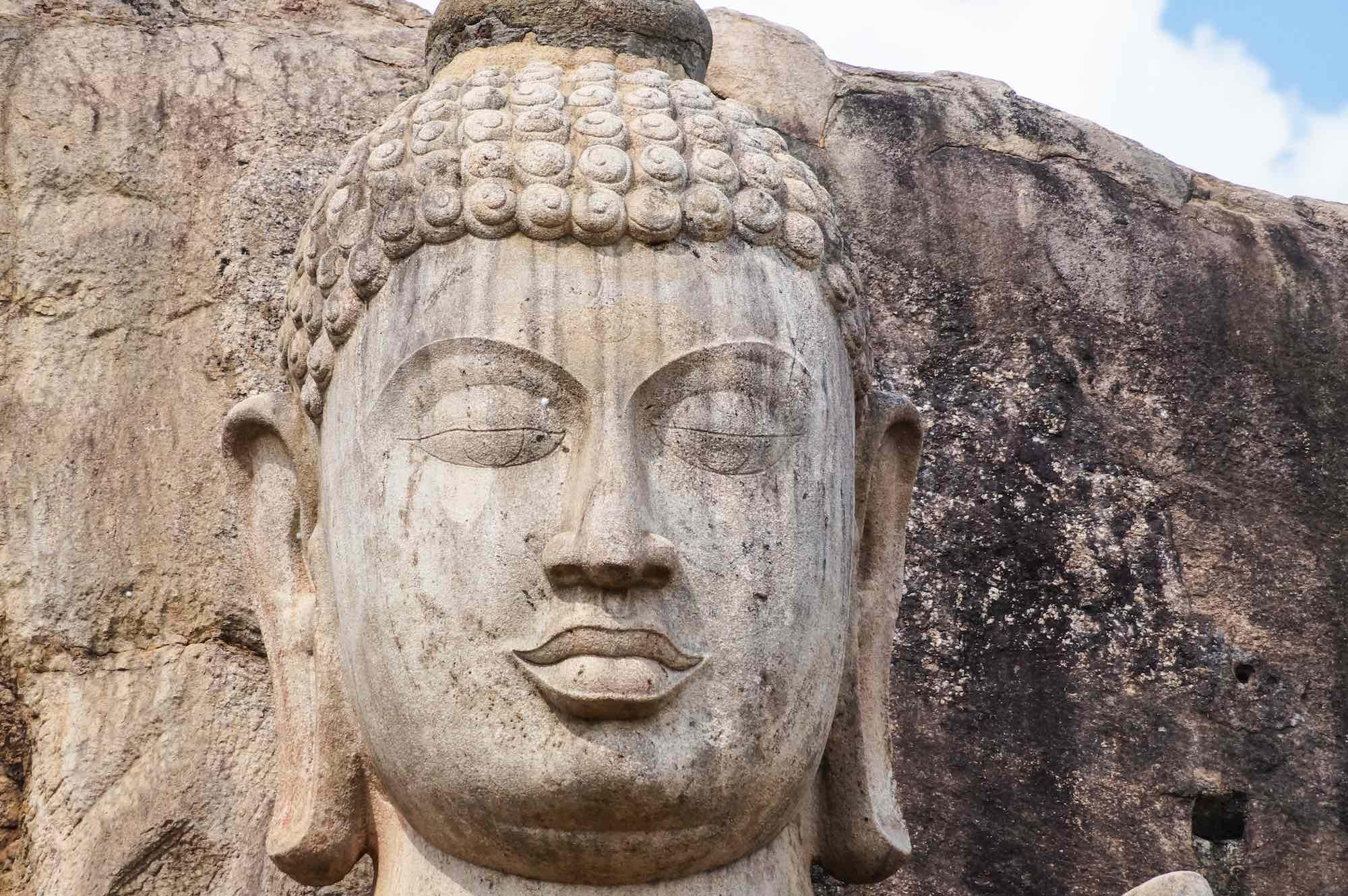 The aukana buddha sri lankas colossal standing rock statue aukana buddha head biocorpaavc Choice Image