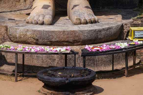 offerings left at the feet of the Aukana Buddha
