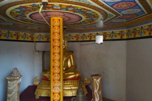 somewhat tacky interior of the stupa