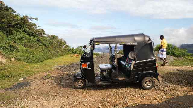 tuk tuk driver waits for his client at Corbet's Gap