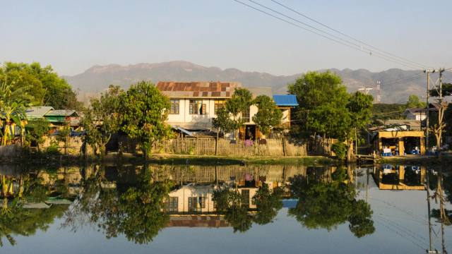canal and buildings on outskirts of Nyaung Shwe