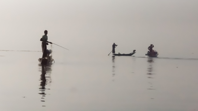 fishermen in the mist - early morning on Inle Lake
