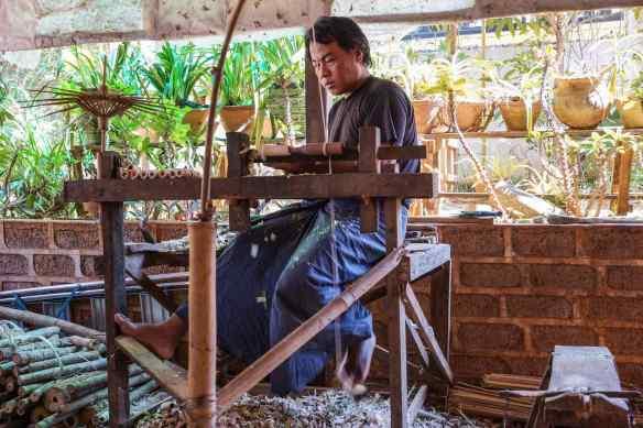 Pindaya craftsperson making parasol handles