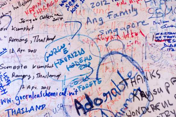 visitors' name tags at the Pindaya crafts cottage