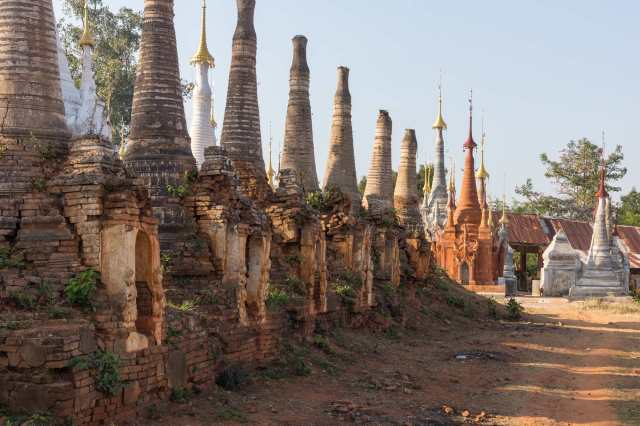 a row of crumbling brick and stucco stupas at Inthein (Indein)