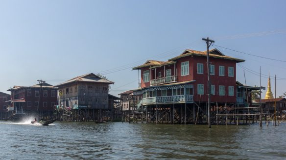 houses on stilts on the shore of Inle Lake