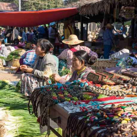 Inle Market woman and goods for sale