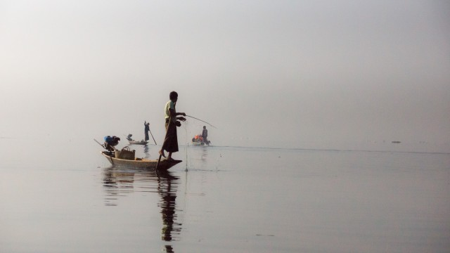 local fishermen and tourists in the morning mist