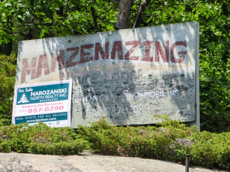 Mahzenazing Lodge Sign with realty notice