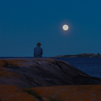 Max contemplating the moon to the east of Martin's island