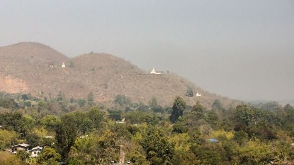 stupas in the hills west of Nyaung Shwe as seen from Nga Phe Kyaung Monastery S of Khaung Daing