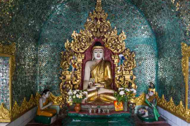 a seated Buddha figure in the Touching The Earth mudra at Yangon's Sule Pagoda