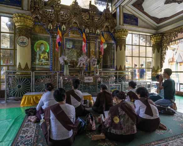 merit seekers at a Sule Paya shrine