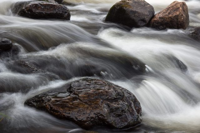 rocks and water in the rapids