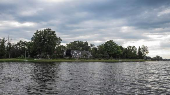 the Otawa River Shoreline - a mix of camps, cottages, and mansions like this one