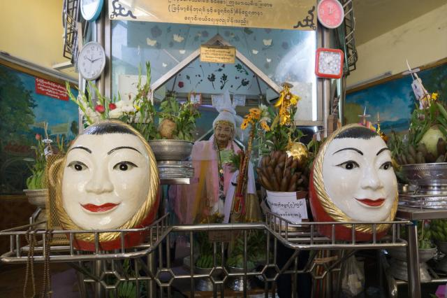 two egg-shaped faces at Sule Paya shrine