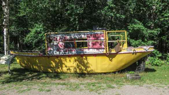 boat used to tug the log booms on the river